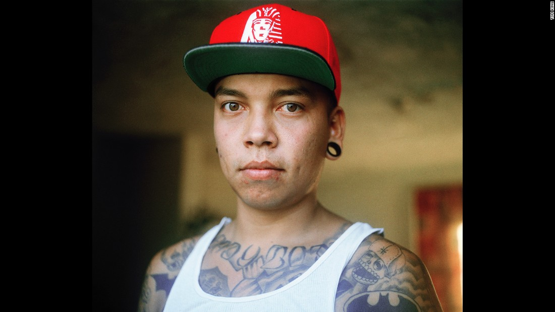 A young man named Alejandro is photographed at his home north of Monterrey, Mexico, in June 2014. He is not affiliated with any gangs, photographer Tom King said, but he has lost a number of friends to violence. King spent two and a half years in the Monterrey area, trying to learn more about its young men and the brutality around them.