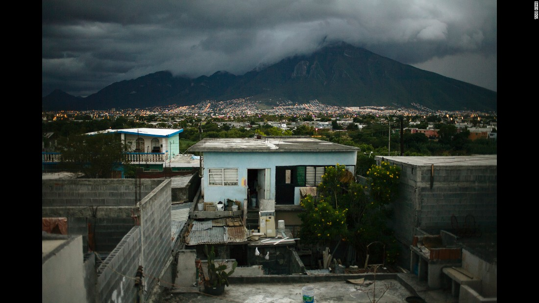 The mountain El Cerro de la Silla serves as the backdrop for Monterrey in this photo from July 2013. The San Rafael neighborhood, seen in the foreground, contains public and informal housing projects, King said.