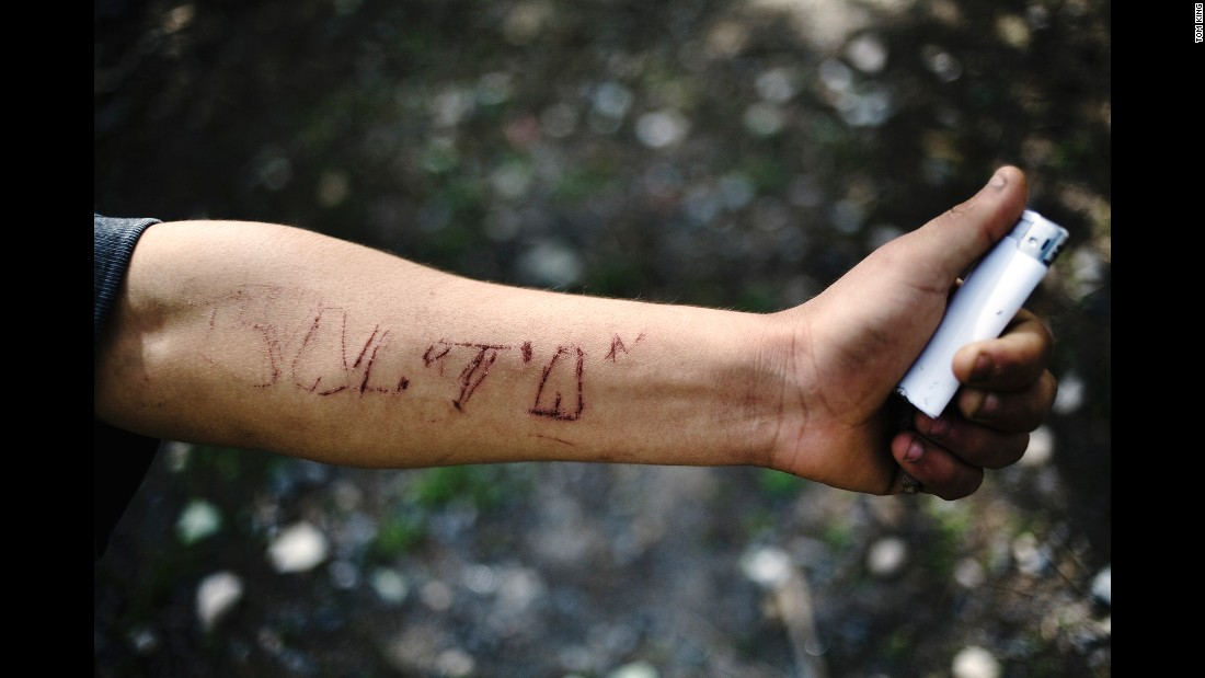"A man named Balta, who King said belonged to the street gang ""Los Pokos Lokos,"" engraved his name into his own arm."
