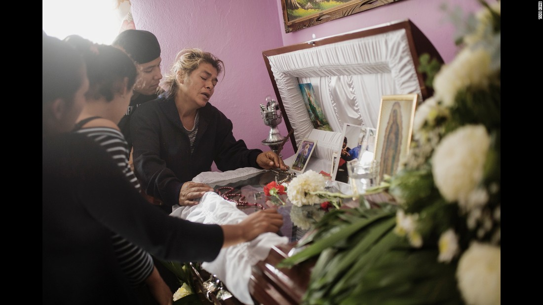 "Doña Tonia mourns over the coffin of her son Manuel in January 2011. Manuel was a member of the street gang ""Los Quimicos,"" King said, and he was kidnapped and murdered by one of the country's drug cartels."