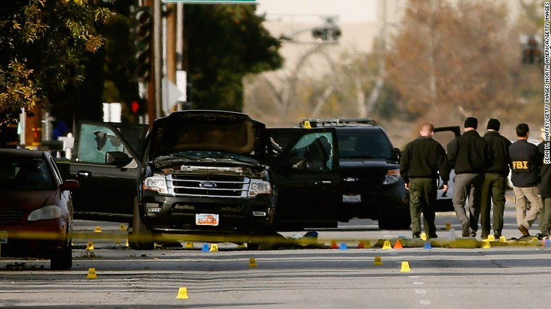 SAN BERNARDINO, CA - DECEMBER 03:  FBI agents and local law enforcement examine the crime scene where suspects of the Inland Regional Center were killed on December 3, 2015 in San Bernardino, California. Police continue to investigate a mass shooting at the Inland Regional Center in San Bernardino that left at least 14 people dead and another 17 injured. (Photo by Sean M. Haffey/Getty Images)