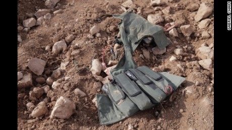 A suicide vest is found on one of the ISIS fighters.