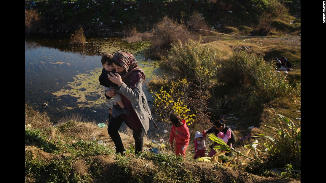 Migrants climb up a hill near the border between Greece and Macedonia.