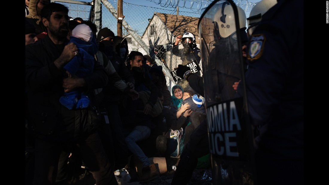 Greek anti-riot police clash with migrants near the border with Macedonia on December 4.