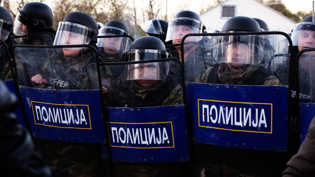 Anti-riot police block the entrance to Macedonia on Wednesday, December 3.