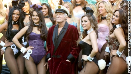 LOS ANGELES, CA - JANUARY 16:  Hugh Hefner (C) poses with Playboy Bunnies, Playmate of the Year 2013 Raquel Pomplun (2nd L) and Miss December 2009 Crystal Hefner (2nd R) at Playboy's 60th Anniversary special event on January 16, 2014 in Los Angeles, California.  (Photo by Rachel Murray/Getty Images for Playboy)
