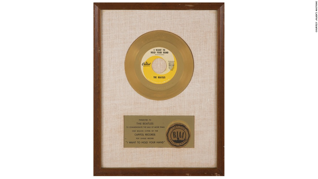"This framed gold record award was presented to the Beatles to commemorate 1 million sales of ""I Want To Hold Your Hand."" It sold for $68,750."