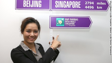 BEIJING, CHINA - SEPTEMBER 30:  Li Na of China poses with the Road to Singapore sign before her retirement ceremony at National Tennis Centre on September 30, 2014 in Beijing, China.  (Photo by Emmanuel Wong/Getty Images)