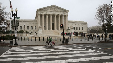 People wait inline to enter the US Supreme Court November 10, 2015 in Washington, DC.