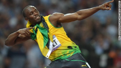 Jamaica's Usain Bolt celebrates after taking the gold in the men's 200m final at the athletics event during the London 2012 Olympic Games on August 9, 2012 in London.  AFP PHOTO / ERIC FEFERBERG        (Photo credit should read ERIC FEFERBERG/AFP/GettyImages)