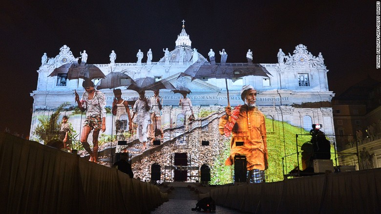 Images projected onto facade of St. Peter's Basilica