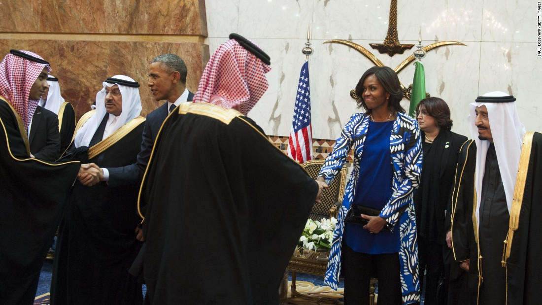 President Obama and first lady Michelle Obama shake hands with delegation members in Riyadh, Saudi Arabia, on Tuesday, January 27. Obama was in the country to meet Saudi King Salman, right, and offer condolences on the death of his predecessor, King Abdullah.