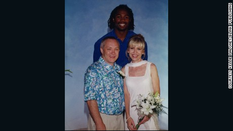 Frank and Tracy Maloney with Lennox Lewis on their wedding day.