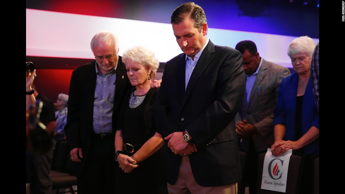 "U.S. Sen. Ted Cruz, a Republican presidential candidate from Texas, prays in Des Moines, Iowa, during the ""Rally for Religious Liberty"" on Friday, August 21."
