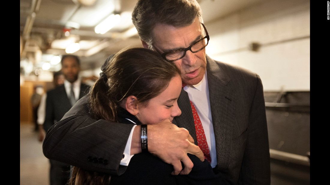 "Former Texas Gov. Rick Perry embraces Madeline Martin, daughter of Eagle Forum President Ed Martin, before speaking at the Eagle Council XLIV in St. Louis on Friday, September 11. During his speech, Perry became the first major presidential candidate <a href=""http://www.cnn.com/2015/09/11/politics/rick-perry-2016-campaign-suspended/index.html"" target=""_blank"">to drop out of the 2016 race.</a>"