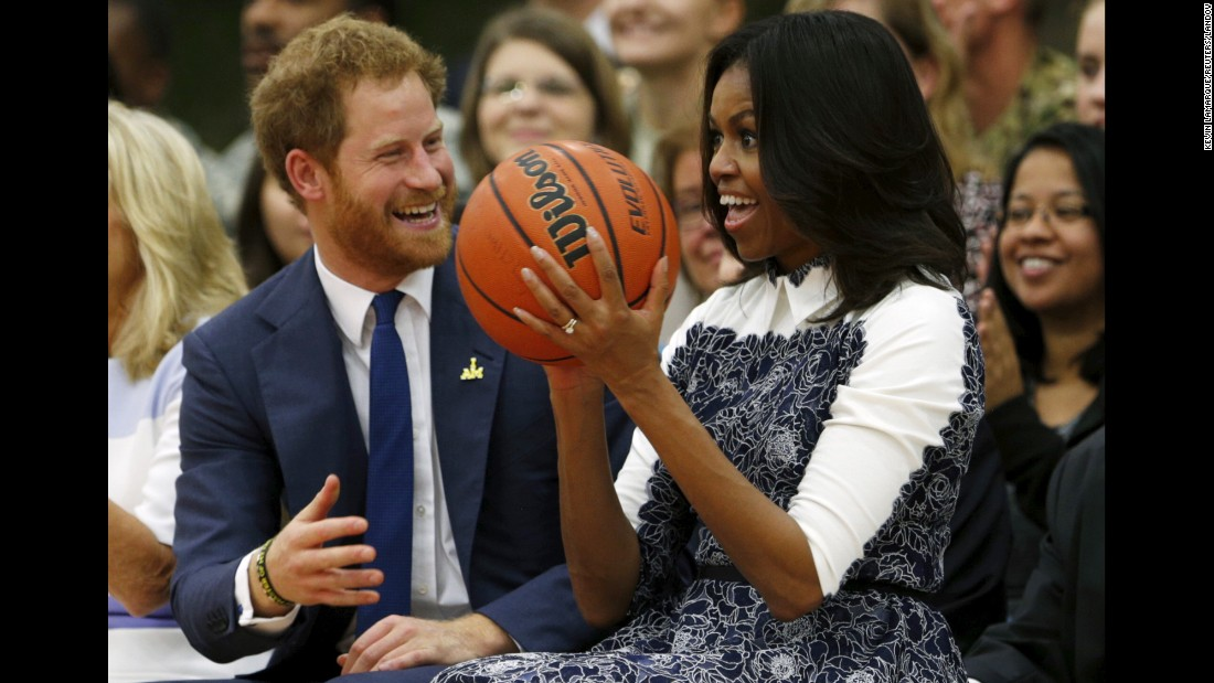 "First lady Michelle Obama and Britain's Prince Harry watch a basketball game played by wounded service members and veterans Wednesday, October 28, at Fort Belvoir, Virginia. Prince Harry was on <a href=""http://www.cnn.com/2015/10/28/us/gallery/prince-harry-in-u-s-/index.html"" target=""_blank"">a one-day visit</a> to the Washington area."