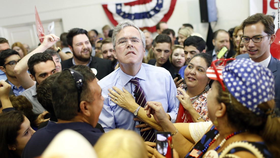 Republican presidential candidate Jeb Bush allows a supporter to loosen his tie during a campaign rally in Tampa, Florida, on Monday, November 2.