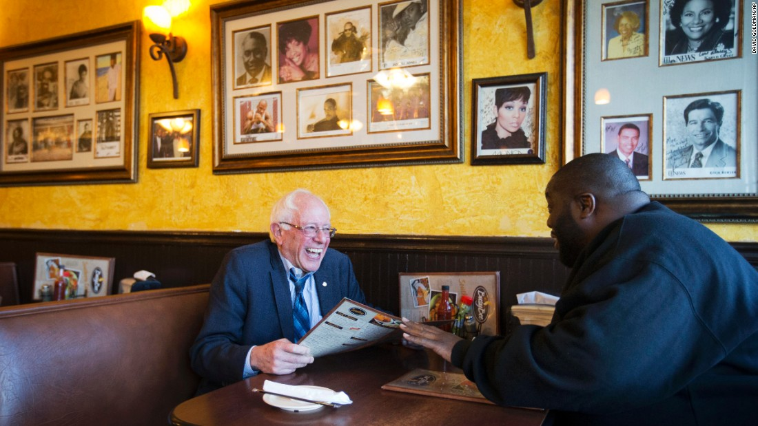 U.S. Sen. Bernie Sanders sits at an Atlanta cafe with rapper Killer Mike on Monday, November 23. The rapper introduced Sanders at a campaign event later in the evening.