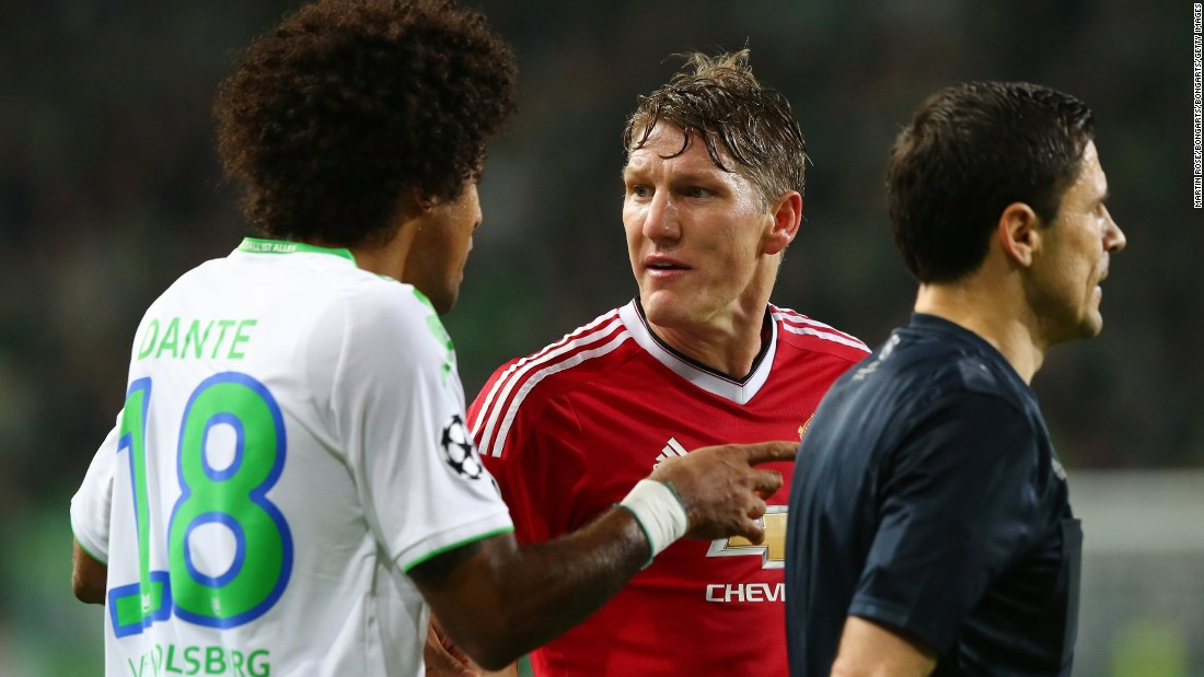 Dante of Wolfsburg and Bastian Schweinsteiger of Manchester United exchange words during the match. Schweinsteiger had a disappointing game and was substituted.