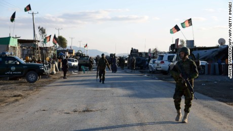 Afghan National Army soldiers stand alert after clashes against security forces at Kandahar Airport on December 9, 2015, a sprawling complex which also houses a joint NATO-Afghan base. At least 37 people were killed when Taliban insurgents wearing military uniforms stormed Kandahar airport, triggering pitched gun battles in a lengthy siege as President Ashraf Ghani on December 9 sought to revive peace talks at a regional conference.The raid on the sprawling complex, which also houses a joint NATO-Afghan base, is seen as the most serious attack on the largest military installation in southern Afghanistan in 14 years of war. AFP PHOTO / Jawed Tanveer  JAWED TANVEER/AFP/Getty Images