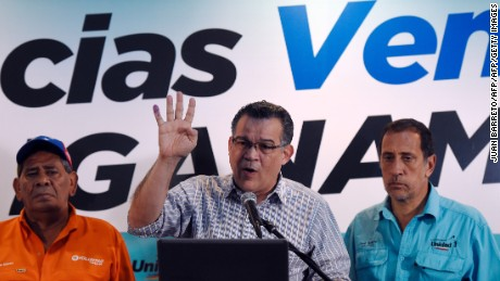 Venezuelan opponent to the government Enrique Marquez (C), speaks during a press conference next to Jose Guerra (R) and Jesus Abreu (L), in Caracas on December 7, 2015. Marquez, Guerra and Abreu were were elected as deputes to the National Assembly. Venezuela's jubilant opposition vowed Monday to drag the oil-rich country out of its economic crisis and free political prisoners after winning control of congress from socialist President Nicolas Maduro. AFP PHOTO/JUAN BARRETO / AFP / JUAN BARRETO        (Photo credit should read JUAN BARRETO/AFP/Getty Images)