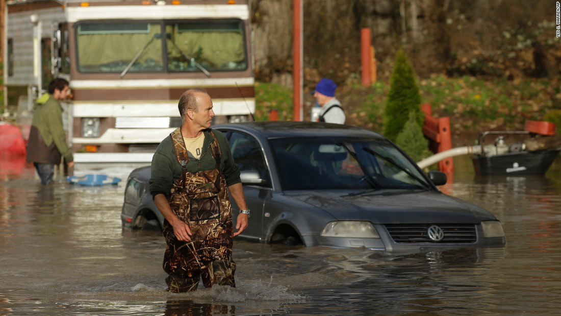 Kevin McLeod, co-owner of the Riverview RV Park, wades through floodwaters December 9 in Puyallup, Washington.