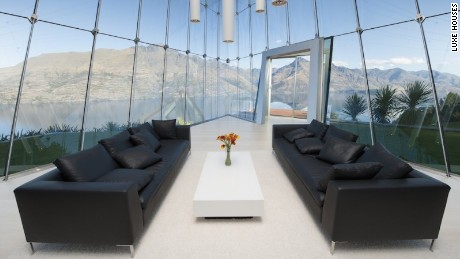 From NZ$10,000, minimum stay one week (5 nights) Suspended high above the waters of Lake Wakatipu and surrounded by the most spectacular mountains, Jagged Edge is quite simply breathtaking. This world-class architectural statement is located just a 10 minute drive from the vibrant heart of Queenstown. Offering guests the opportunity to be seduced by the incredible views and vast open spaces this outstanding property is a truly unique experience. Indulge yourself in the hot pool to the front of the house where you will feel like you are simply floating above the mountains. All bedrooms are located on the first floor which is completely suspended from the roof . The perimeter walls are constructed of glass making the most of the 270 degree views. The interiors have been kept stylishly minimal which all adds to highlight the sweeping vistas outside. Each bedroom has commanding views of the lake and beyond and all are complete with ensuites. From the master bedroom bed you can look directly at the panoramic view of the iconic Remarkables Mountain Range. A wall separating the bedroom from the living space below retreats at the touch of a button. From there you also have a full view to the west towards Glenorchy. Downstairs on the ground floor the views are equally spectacular. With various areas to sit and relax and take in the environment, this is the ultimate viewing platform for Queenstowns surrounding mountains and lake. The glossy white kitchen, grand piano, media room and large indulgent hot pool are all located on the ground floor. This ensures you will never have to leave this relaxing sanctuary. Push a button and a section of the floor elevates, becoming a bar lit by adjustable coloured lights. The private underground wine cellar is excavated into the schist rockface to the rear of the house. Should your group exceed 6 visitors there is also the option to stay in the Guest House located down a small walkway from Jagged Edge. It can sleep up to an additional 10 people and is a stunning residence in its own right. Featuring large bedrooms all with spectacular views, this home also offers a swimming pool, spa pool, gymnasium and sauna. The views from the large sweeping balcony are just as outstanding as what Jagged Edge has to offer. Both of these locations will cater to those where privacy and security are paramount. Please contact us now for more information on securing Jagged Edge with the option of the Guest House for additional visitors (up to 10 guests). Rates From NZ$10,000, minimum stay one week (5 nights) Location Suspended high above the waters of Lake Wakatipu and surrounded by the most spectacular mountains, Jagged Edge is quite simply breathtaking.