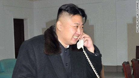 This picture taken by North Korea's official Korean Central News Agency (KCNA) on December 12, 2012 shows North Korean leader Kim Jong-Un celebrating the launch of the Unha-3 rocket, carrying the satellite Kwangmyongsong-3, at the general satellite control and command center in Pyongyang.  AFP PHOTO / KCNA VIA KNS