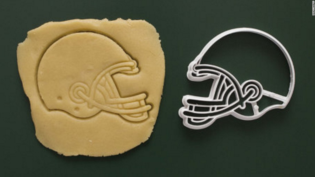 "If your loved one's hobbies are as varied as baking and sports, then a football-shaped cookie cutter could be just the right stocking stuffer. <a href=""https://www.etsy.com/listing/475354972/sports-football-baseball-basketball?ga_order=most_relevant&ga_search_type=all&ga_view_type=gallery&ga_search_query=sports%20cookie%20cutters&ref=sr_gallery_2"" target=""_blank"">Available on Etsy</a>, these baking tools come in the form of helmets, footballs, soccer balls and baseballs."
