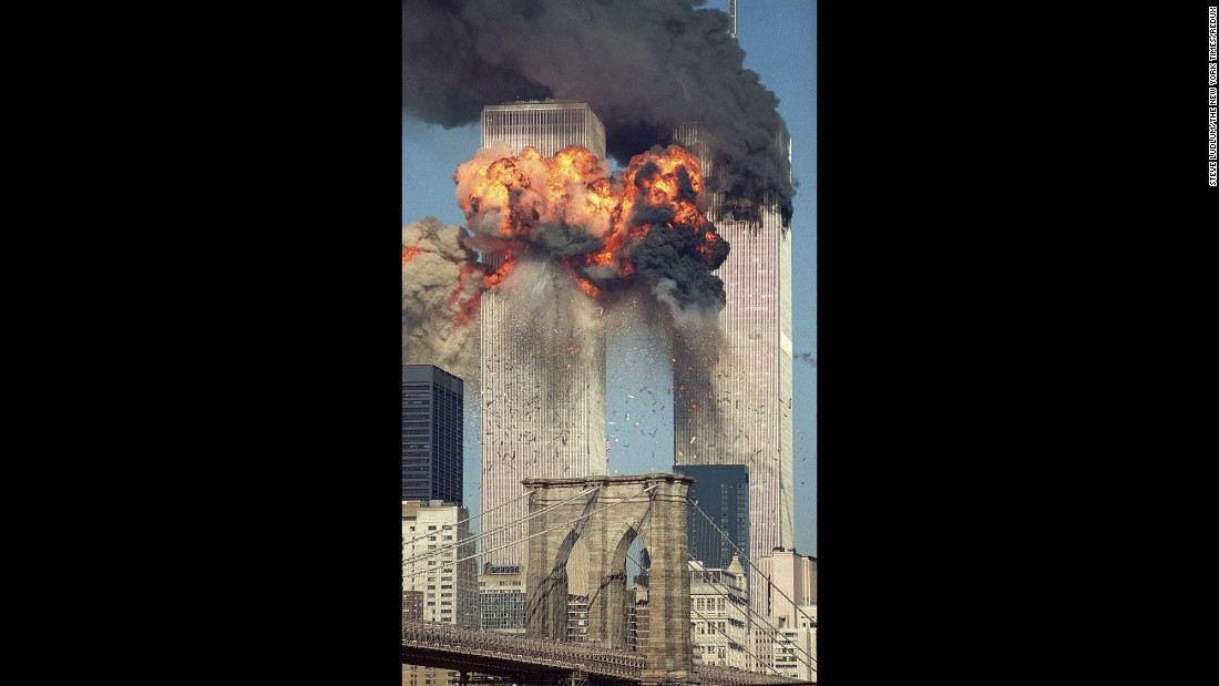 The second of two hijacked airliners -- United Airlines Flight 175 from Boston -- crashes into the south side of the South Tower of the World Trade Center on September 11, 2001. Smoke billows from the North Tower, where American Airlines Flight 11 had crashed about 15 minutes earlier. Both 110-story towers collapsed shortly afterward. Other hijacking crashes that day in Pennsylvania and at the Pentagon left a total of 2,977 victims dead. This 2002 Pulitzer Prize-winning photograph was taken by Steve Ludlum.