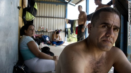 Cubans from a group of 150 rest in a shelter in the town of La Cruz , Guanacaste, Costa Rica, near the border with Nicaragua on November 17, 2015. A surge of some 2,000 Cuban migrants trying to cross Central America to reach the United States triggered a diplomatic spat between Costa Rica and Nicaragua Monday, plunging tense relations between the two countries to a new low. AFP PHOTO / Ezequiel BECERRA        (Photo credit should read EZEQUIEL BECERRA/AFP/Getty Images)