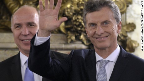 Argentina's President Mauricio Macri (R) waves next to Supreme Court President Ricardo Lorenzetti  during his inauguration ceremony at the Casa Rosada government palace in Buenos Aires on December 10, 2015. Macri's inauguration marks the start of a new era for Argentina: a tilt to the right after 12 years under Kirchner and her late husband Nestor, the left-wing power couple that led the country back to stability after an economic meltdown in 2001.  AFP PHOTO / JUAN MABROMATA / AFP / JUAN MABROMATA        (Photo credit should read JUAN MABROMATA/AFP/Getty Images)