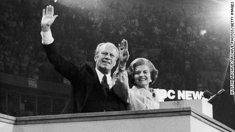 President Gerald Ford and his wife, First Lady Betty Ford, wave to delegates at the Republican National Convention after he was nominated to run for a second term on August 19, 1976 in Kansas City, Missouri.