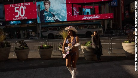 Patricia Burck performs in Times Square as the Naked Cowgirl in December 2015 during a warm spell.