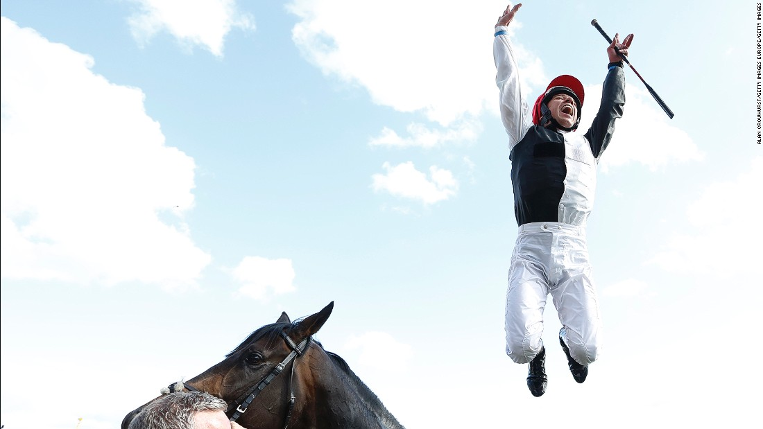 Dettori performs his trademark leap from Golden Horn after winning the Epsom Derby in June.