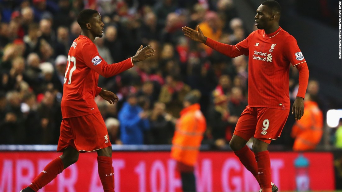 Divock Origi (left) celebrates his late equalizer for Liverpool in the 2-2 home draw with West Brom with teammate Christian Benteke.