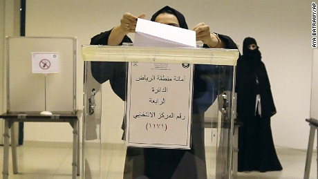 A Saudi woman casts her ballot at a polling center during municipal elections, in Riyadh, Saudi Arabia, Saturday, Dec. 12, 2015. Saudi women are heading to polling stations across the kingdom on Saturday, both as voters and candidates for the first time in this landmark election. (AP Photo/Aya Batrawy)