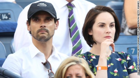 John Dineen and Michelle Dockery watch the U.S. Open tennis tournament in 2013.