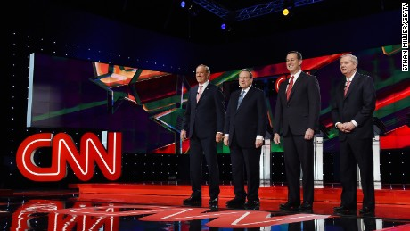 Republican presidential candidates George Pataki, Mike Huckabee, Rick Santorum and Sen. Lindsay Graham are introduced during the CNN presidential debate at The Venetian Las Vegas on December 15, 2015.
