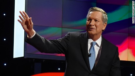 Republican presidential candidate Ohio Gov. John Kasich waves as he is introduced during the CNN presidential debate at The Venetian Las Vegas on December 15, 2015.