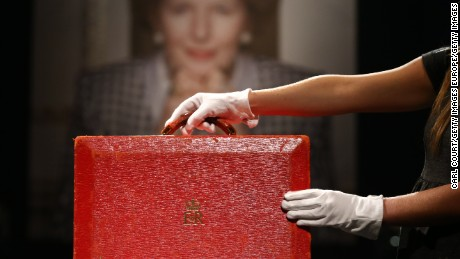 LONDON, ENGLAND - DECEMBER 15:  A member of staff poses with a 'Prime Ministerial Red Morocco Dispatch Box' during a press preview at Christies auction house on December 15, 2015 in London, England. Due to form part of the 'Mrs Thatcher - Property from the Collection of The Right Honourable The Baroness Thatcher of Kesteven LG, OM, FRS' sale on December 15th, it is expected to fetch between 3,000-5,000 GBP 4,600-7,600 USD - 4,300-7,000 EUR.  (Photo by Carl Court/Getty Images)