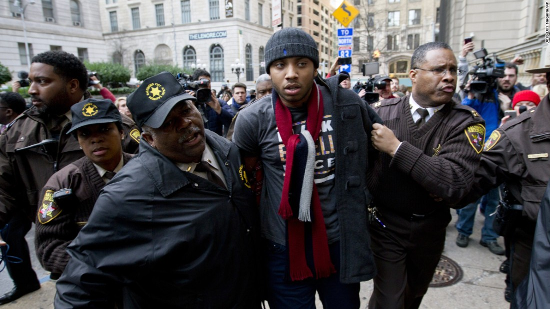 "A demonstrator is detained outside a Baltimore courthouse on Wednesday, December 16, after the <a href=""http://www.cnn.com/2015/12/16/us/baltimore-police-trial-freddie-gray/index.html"" target=""_blank"">mistrial of William Porter,</a> one of six Baltimore police officers charged in connection with the death of Freddie Gray. Jurors said they were deadlocked and unable to reach a unanimous verdict."
