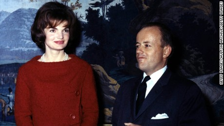 First Lady Jacqueline Kennedy poses for a photograph with James Hoban Alexander at the White House December 5, 1961 in Washington, DC.