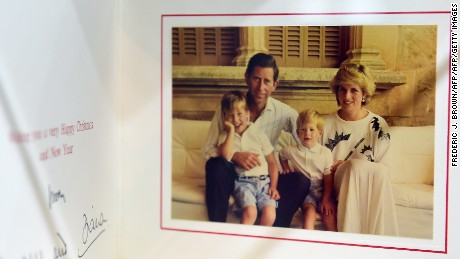 A 1987 Christmas card signed by Prince Charles and Princess Diana with their children, Prince William and Prince Harry.