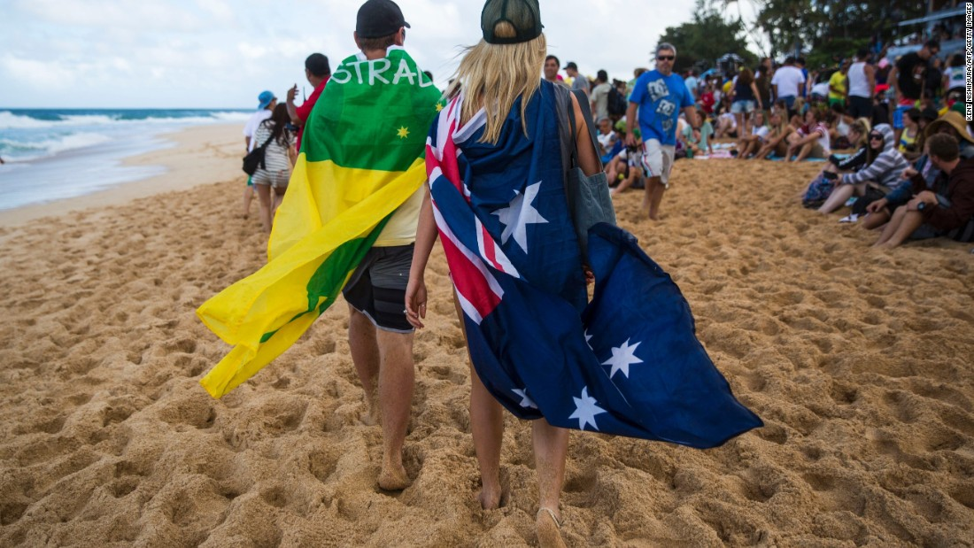 Visitors from Perth, Australia show their support for surfers on both sides.