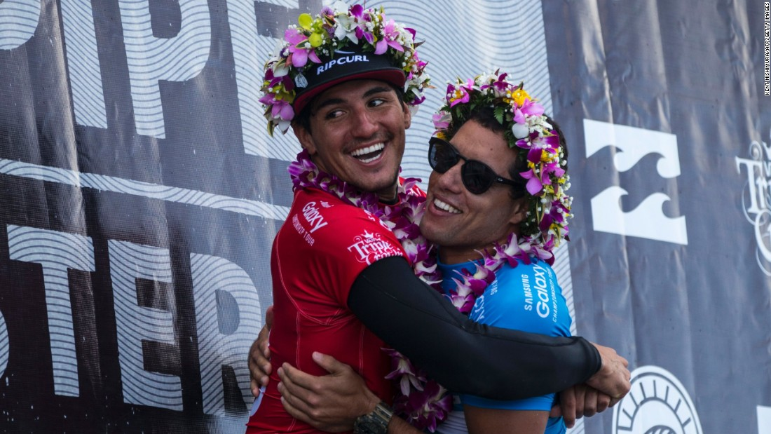 Brazilian finalists Gabriel Medina and newly-crowned World Champion Adriano de Souza hug during the awards ceremony on December 17.