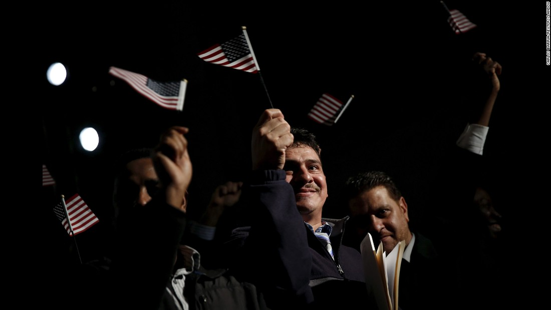 People celebrate their U.S. citizenship during a naturalization ceremony in Washington on Tuesday, December 15.