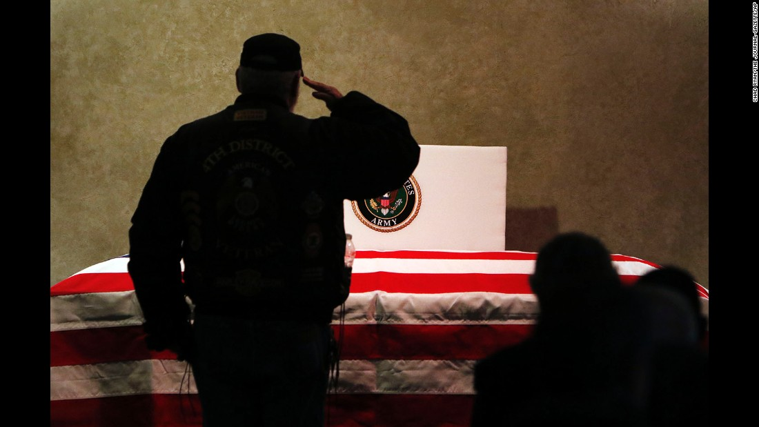 A man salutes the casket of Vietnam veteran James Beavers before his funeral in Fort Wayne, Indiana, on Thursday, December 17. Beavers had no known family or friends to direct the handling of his remains. But hundreds of veterans, military members and everyday citizens attended the service and paid their respects during his funeral.