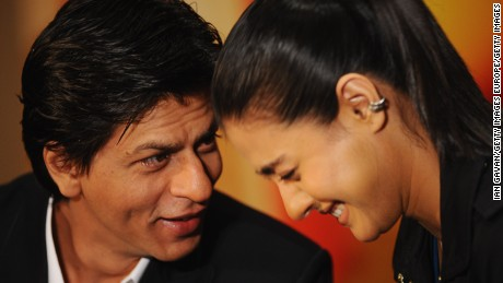 Shah Rukh Khan and Kajol share a moment.