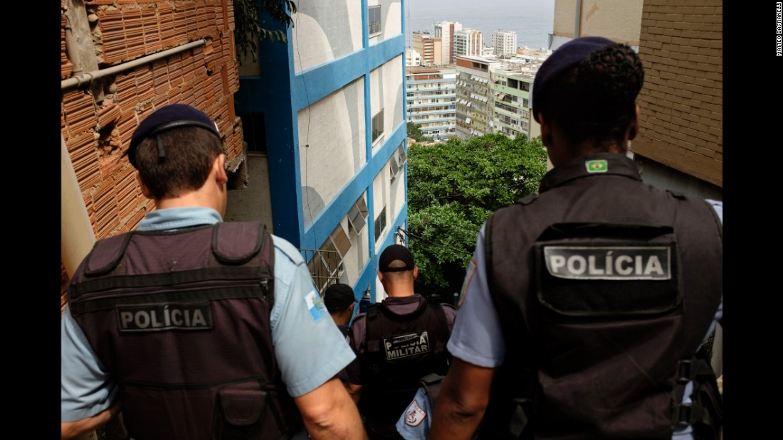 "A Police Pacification Unit monitors the Cantagalo favela. Launched in 2008, the ""pacification"" program has been put in place in nearly 40 favelas and has received mixed reviews. It was designed to limit the reach of armed drug gangs by installing permanent police posts within the favelas where they typically operated."